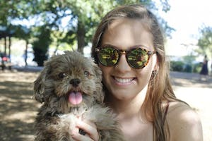 UNC sophomore Laura Perron enjoys a Sunday afternoon with her dog, Hershey, at Weaver Street Market, a dog friendly establishment in Carrboro.