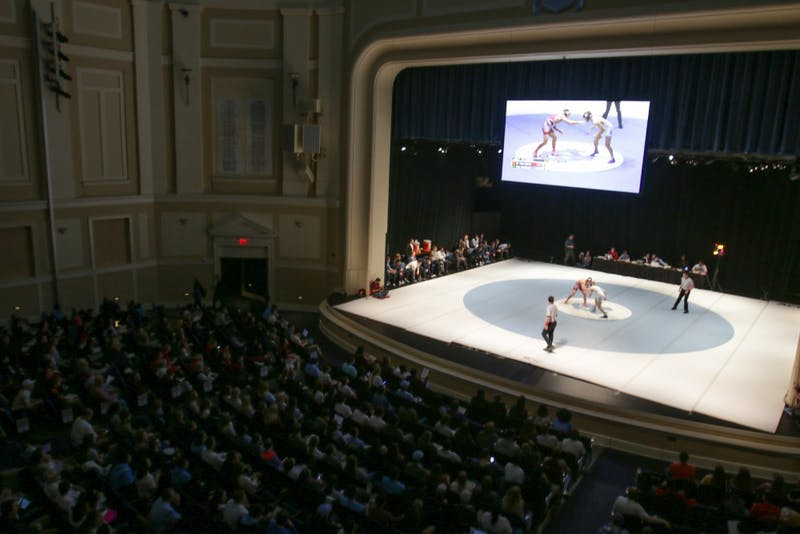 "UNC wrestling squared off against NC State in the ""Brawl at the Hall"" on Monday night. The match took place on the stage in Memorial Hall."