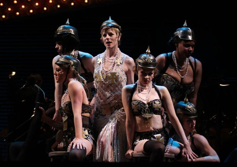"Lisa Brescia (center) performs in Playmakers' Cabaret as Sally Bowles performing the number ""Mein Herr"" with members of the cast."