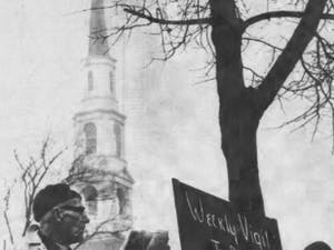 DTH Archive, Jan. 5, 1967. The first weekly peace watch was held yesterday afternoon with up to 100 to 150 protestors in attendance. Photo by Jock Lauterer.