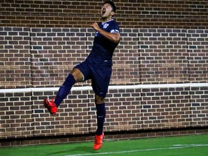 Senior midfielder Mauricio Pineda (2) celebrates his first goal in the 3-1 win over West Virginia on Tuesday, Oct. 8, 2019 on Dorrance Field.