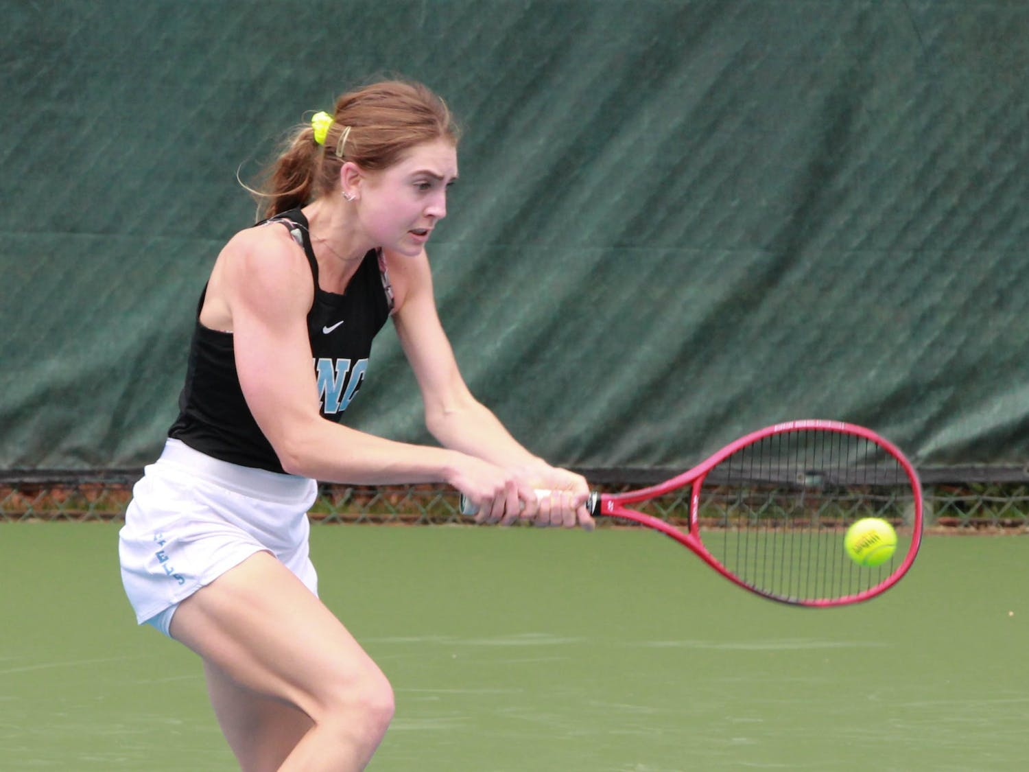 UNC first-year Fiona Crawley returns a volley during a singles' match on March 28, 2021 at Cone-Kenfield Tennis Center. The Tar Heels defeated the Fighting Irish 7-0.