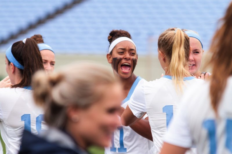 North Carolina women's lacrosse players get energized before their quarterfinal game on May 19.