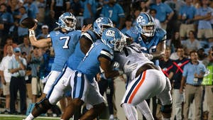 UNC junior quarterback Sam Howell (7) throws the ball down the field in the Tar Heels' home football game in Kenan Memorial Stadium against the University of Virginia Cavaliers on Sept. 18, 2021. The Tar Heels won 59-39.