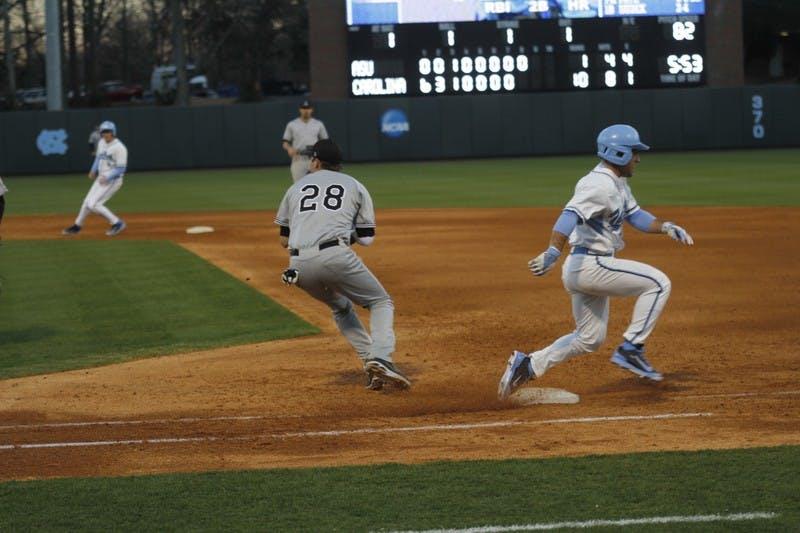 UNC outfielder Michael Massardo battles Appalachian State's Tyler Zupcic at first base.