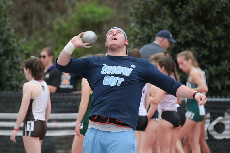 Sophomore Daniel McArthur throws the shot put at the Raleigh Relays on March 30.