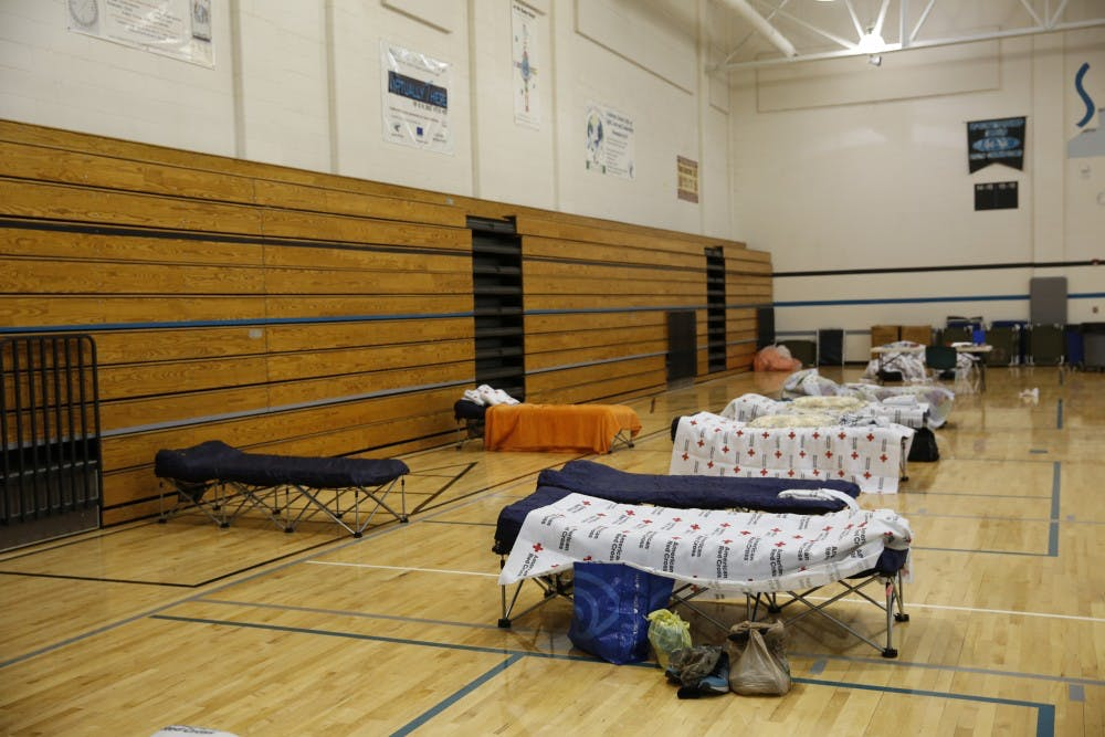 Orange County families brace Florence at Smith Middle School
