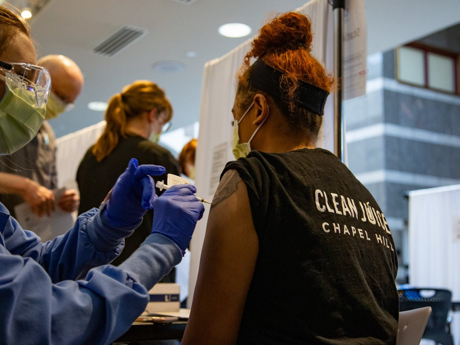 High school senior and Chapel Hill resident Maliah Austine receives her first dose of a COVID-19 vaccination at the Friday Center  on Monday, Mar. 22, 2021. Austine,  a member of N.C. vaccination Group 3, has been working at her in-person job for several months during the pandemic.