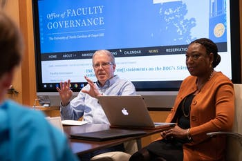 Jim Leloudis (middle) and Patricia Parker (right), co-chairs of UNC's new Reckoning Commission, discuss the Commission on History, Race and a Way Forward with Jennifer Larson (left) during the Faculty Executive Meeting at South Building on Monday, Jan. 13, 2020.