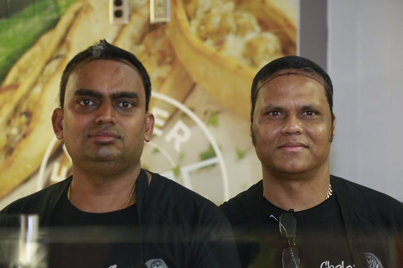 Wednesday morning on Februrary 5, 2020, Raja and Durai prepare to open CholaNad, a restaurant in the bottom of Lenoir. They are from Tamil Nadu, a region that inspires many CholaNad dishes.