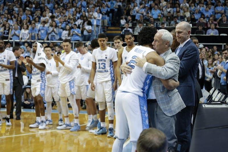 North Carolina senior guard Joel Berry II (2) hugs head coach Roy Williams after giving his senior night speech on Feb. 27 at the Smith Center.
