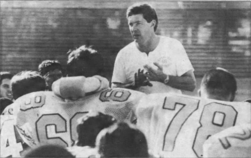 Head coach Mack Brown speaks to his North Carolina football team in 1989, ahead of his second year with the program. Brown went a combined 2-20 in his first two seasons with UNC. DTH File Photo.