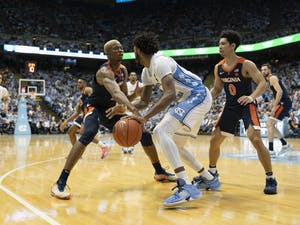 UNC sophomore guard Leaky Black (1) and Virginia senior forward Mamadi Diakite (25) fight for possession of the ball at the Smith Center on Feb. 15, 2020. UNC lost 64-62.