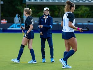UNC head coach Karen Shelton talks to her players during warmups before UNC plays Boston College in Karen Shelton Stadium Nov. 5, 2020. The Tar Heels beat the Eagles 4-0 in the first round of the ACC playoffs, securing Shelton's 700th win.