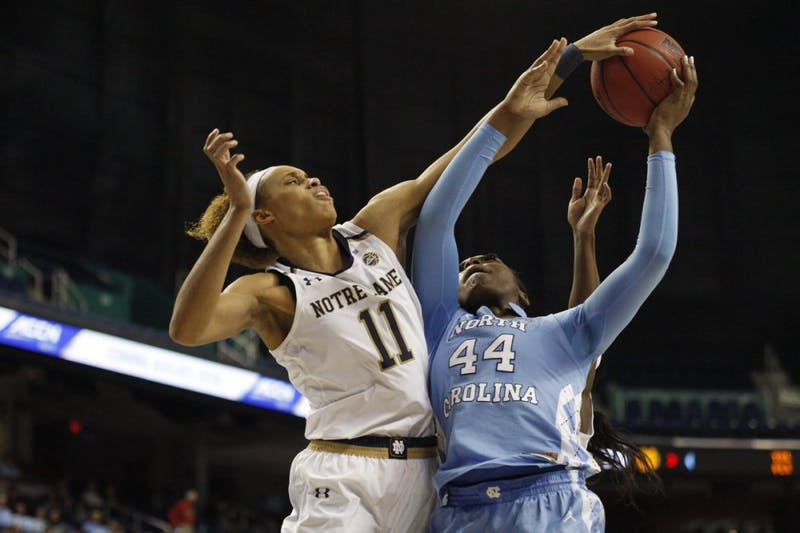 North Carolina sophomore forward Janelle Bailey goes up for a shot against Notre Dame forward Briana Turner in an ACC Tournament second-round matchup on March 8, 2019.