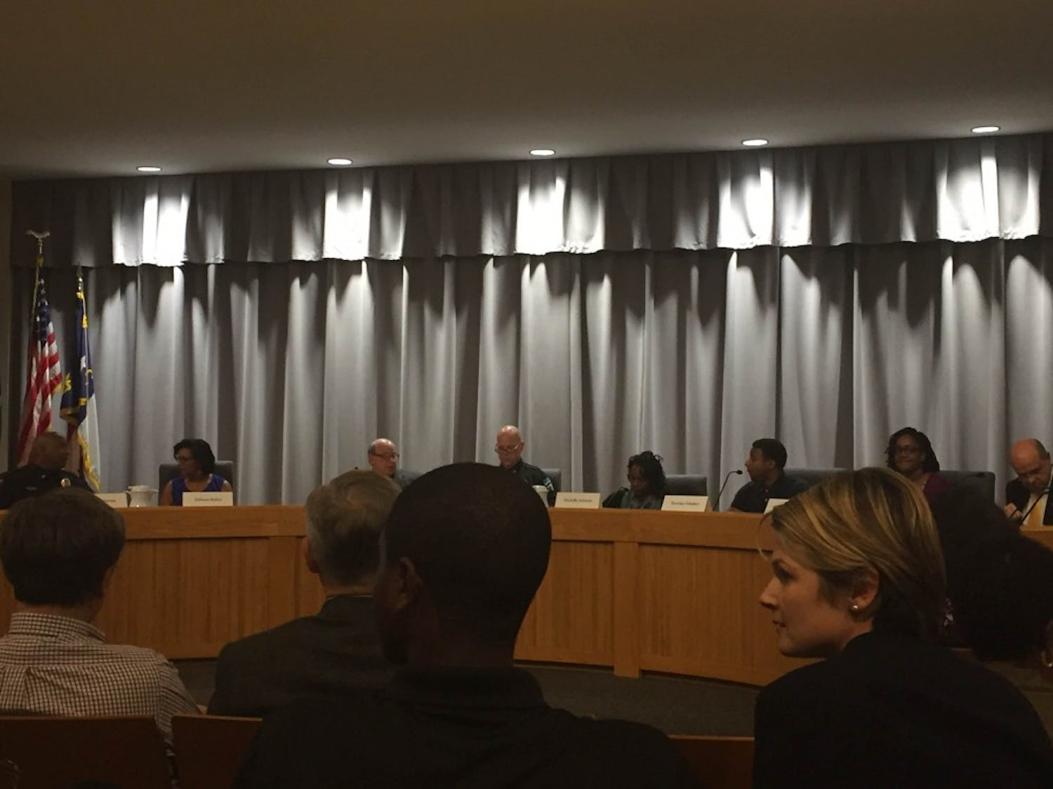 Law enforcement officials and community members hold public forum on police, race, and community in chapel hill town hall on Monday.