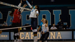 In the Sept. 18 game against Davidson, junior middle blocker Skyy Howard (8) knocks the ball over the net for a point. UNC won three out of three sets.