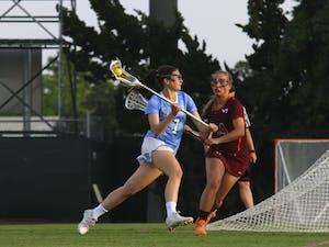 Ela Hazer (7) looks for an open pass over a Virginia Tech defender.