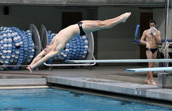 Jack Nyquist dives in Koury Natatorium at the match against NC State this past Friday night.