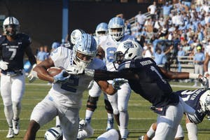 Running back Jordon Brown (2) fights off an ODU defender on Saturday at Foreman Field.