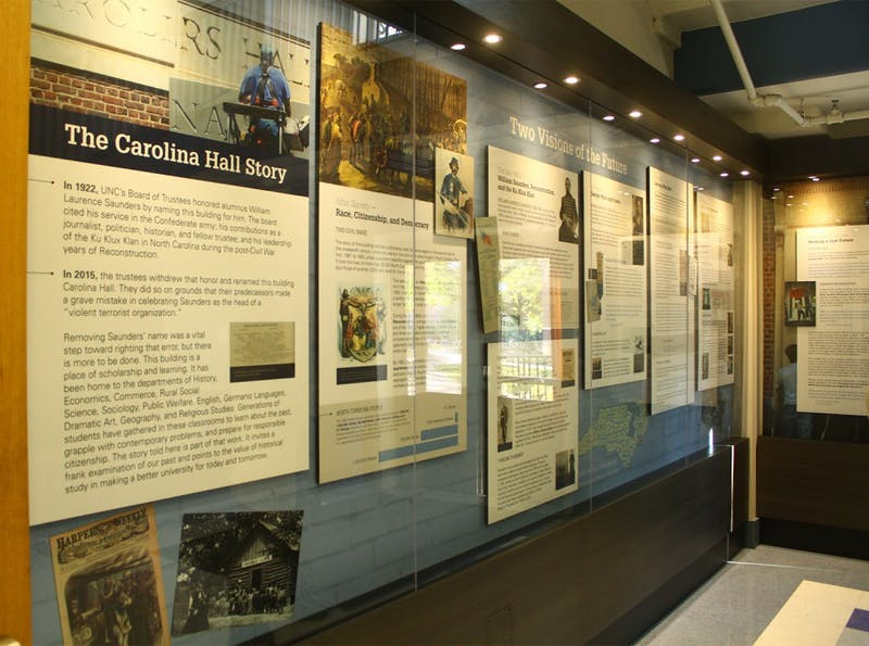 A permanent exhibit in the entrance of Carolina Hall detailing the building's history. The hall was originally named for William Saunders, former leader of the N.C. Klan and UNC Trustee.