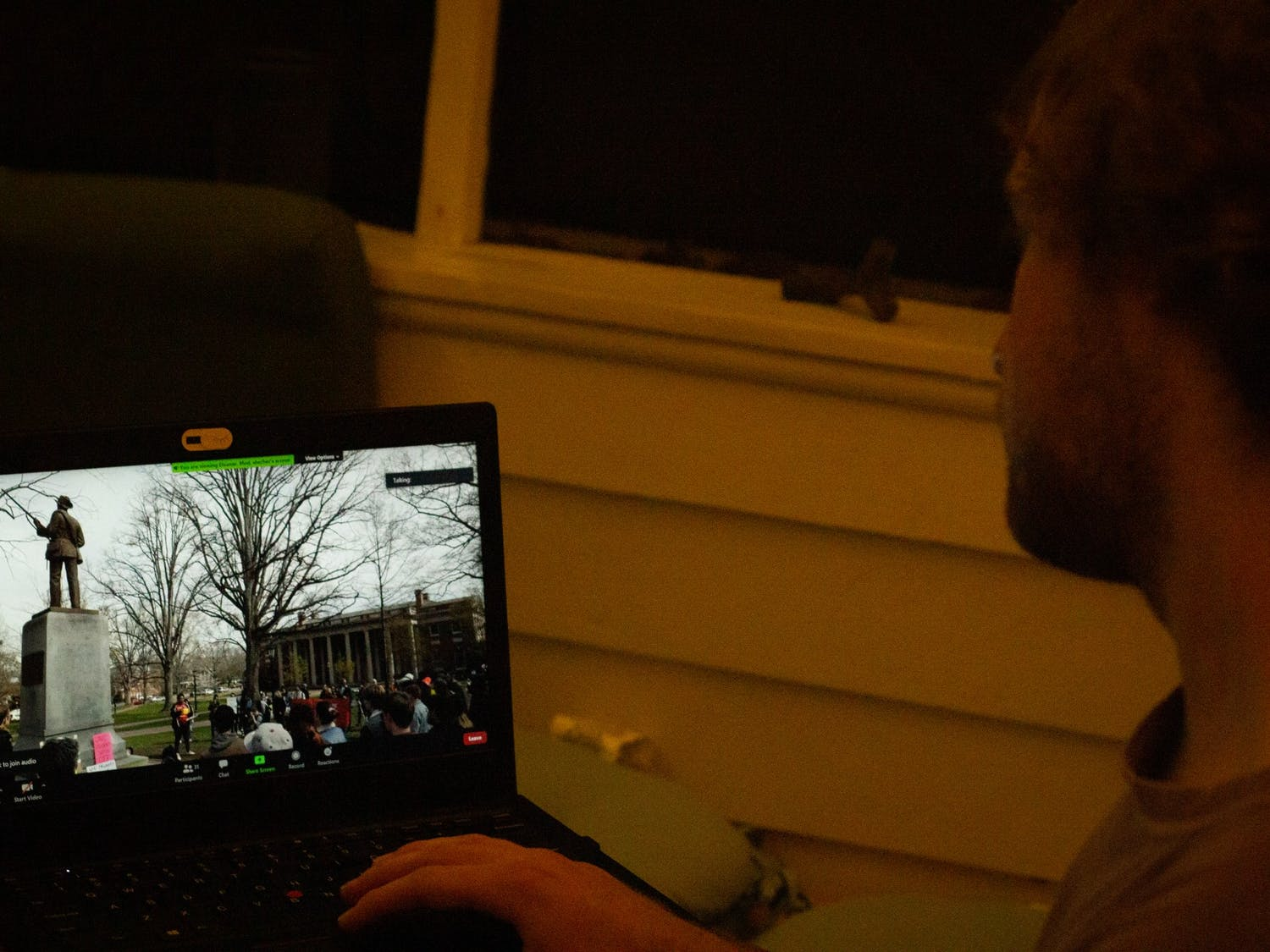 """UNC senior Roy Clinard watches """"Silence Sam"""" on Wednesday, Oct. 14th. The student made documentary details the systemic silencing of students perpetuated by law enforcement and university officials."""