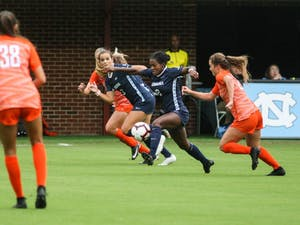 Freshman forward Isabel Cox (13) and sophomore midfielder Brianna Pinto (8) dribble the ball upfield during a game against Clemson on Saturday, Oct. 5th, 2019. UNC beat Clemson 1-0.