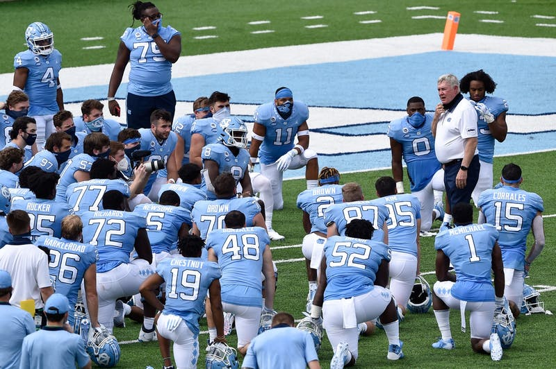 UNC football coach Mack Brown speaks before members of the football team after their win against Syracuse in Kenan Stadium on Saturday, Sept. 12, 2020.