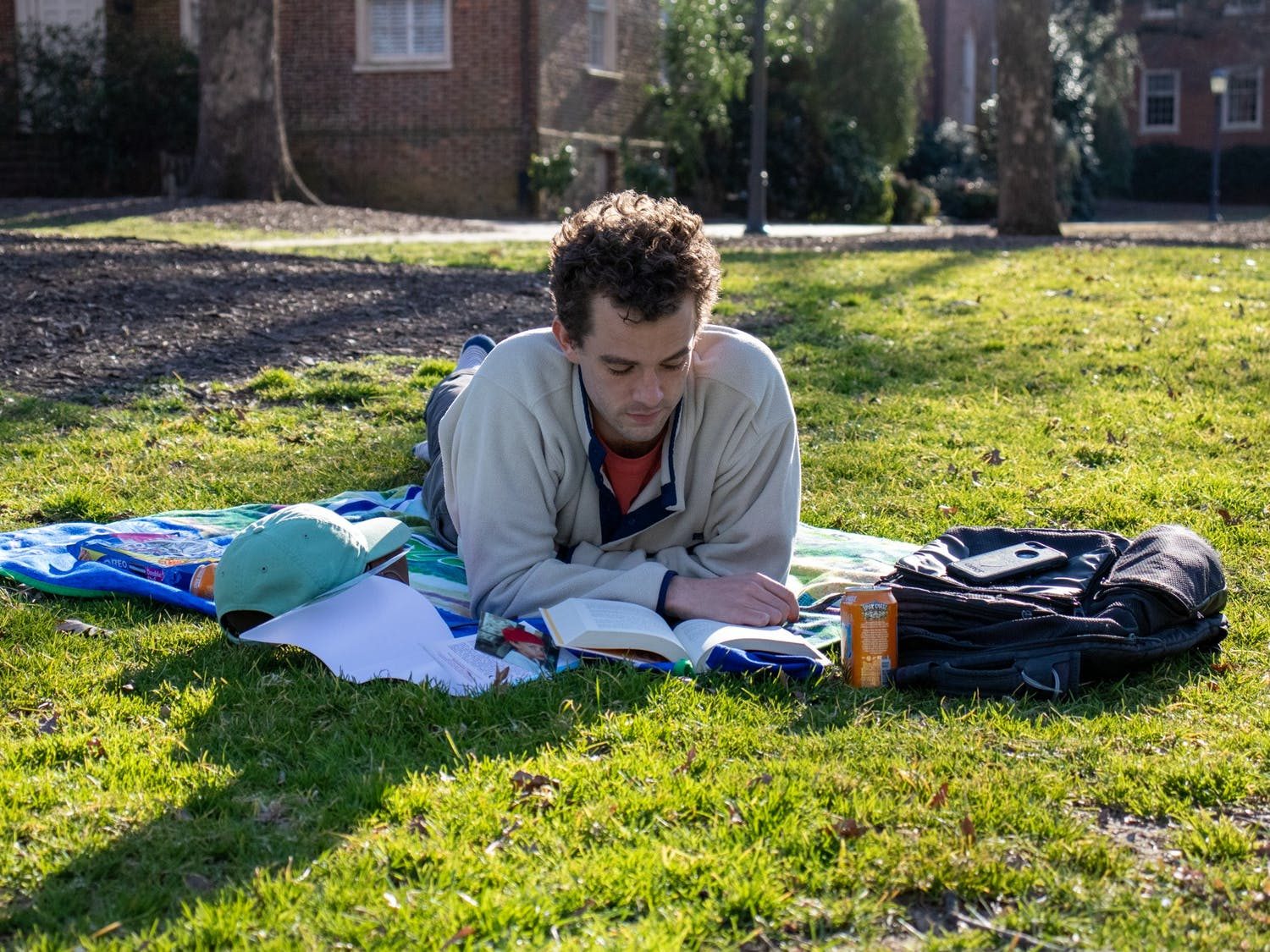 Ben Boatwright, second year at the UNC School of Law, reads a book at McCorkle Place in Chapel Hill on March 7, 2021.