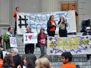Students and faculty gathered to rally on the steps of Wilson Library on Wednesday.