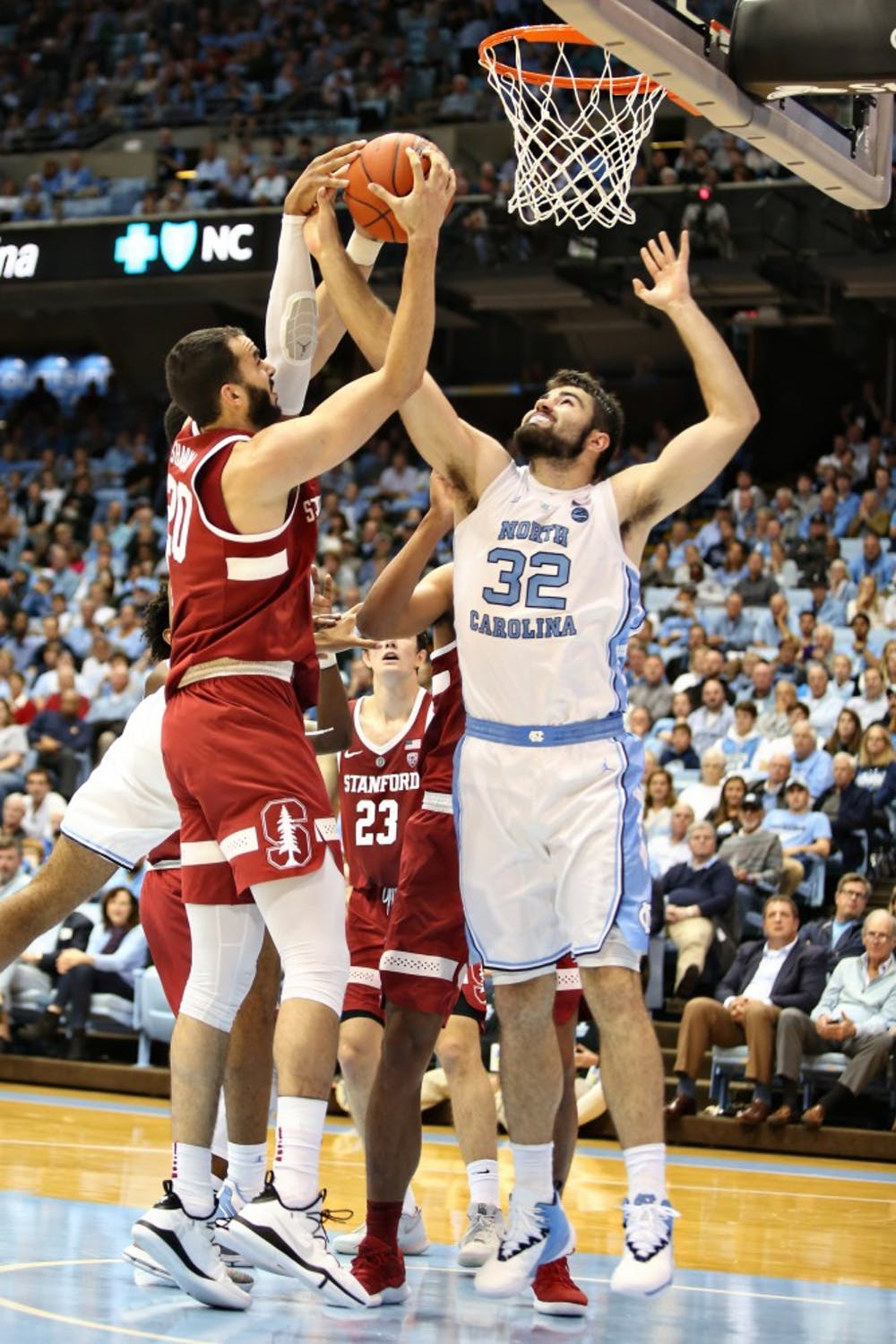 UNC forward Luke Maye (32) guards Stanford center Josh Sharma (20) as he pulls up for a shot in the Dean Smith Center on Monday, Nov. 12, 2018. UNC won 90-72.