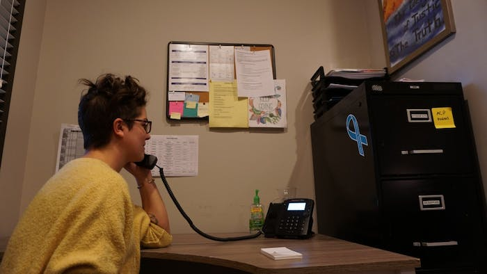 Rachel Valentine, executive director for the Orange County Rape Crisis Center in Chapel hill, answers the phone in an office designated for first responses to clients on Wednesday, Jan. 16, 2019.
