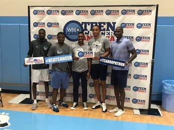 Former Tar Heel Brice Johnson (second on the right) poses at the Teen Cancer America Hoop-a-Thon rivalry event.