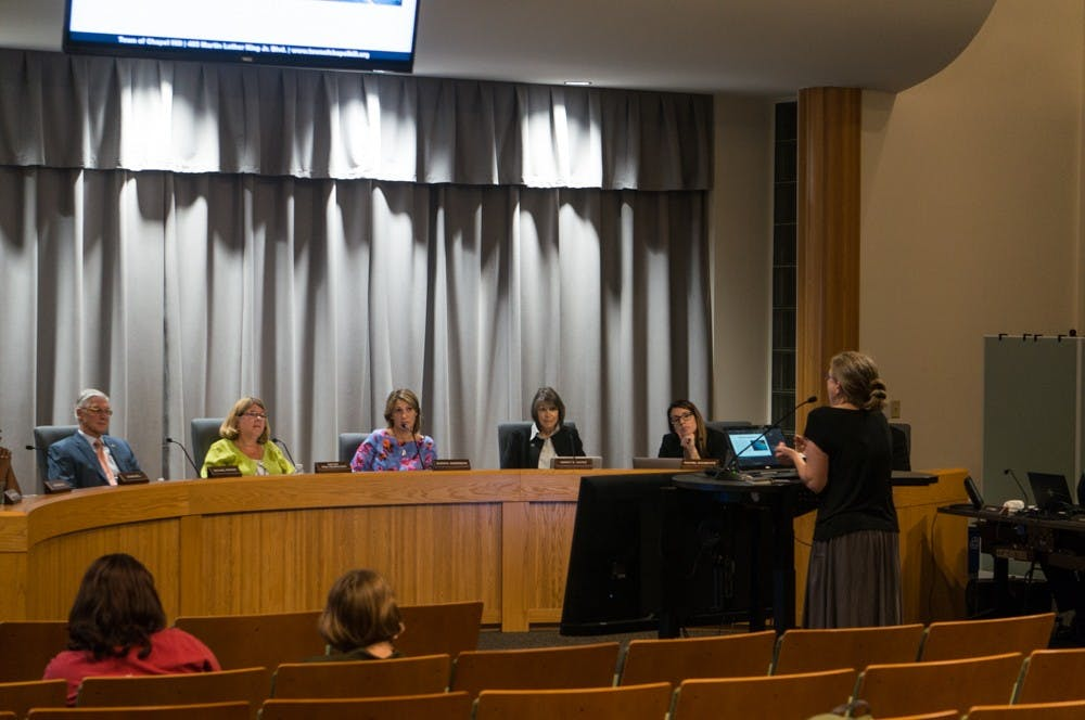 <p>Chapel Hill citizen Kim Piracci delivers a passionate call for climate action on behalf of the town council, regardless of financial concerns, at the Town Council meeting on Wednesday, Sept. 25th, 2019.</p>