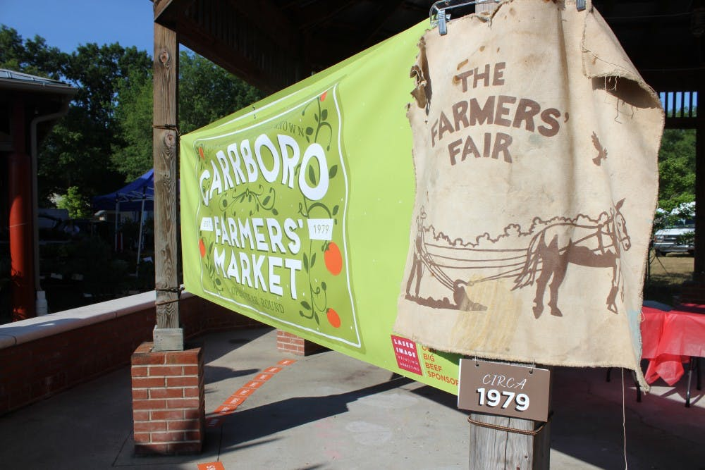 Carrboro Farmers' Market celebrates 40th birthday with cake and community