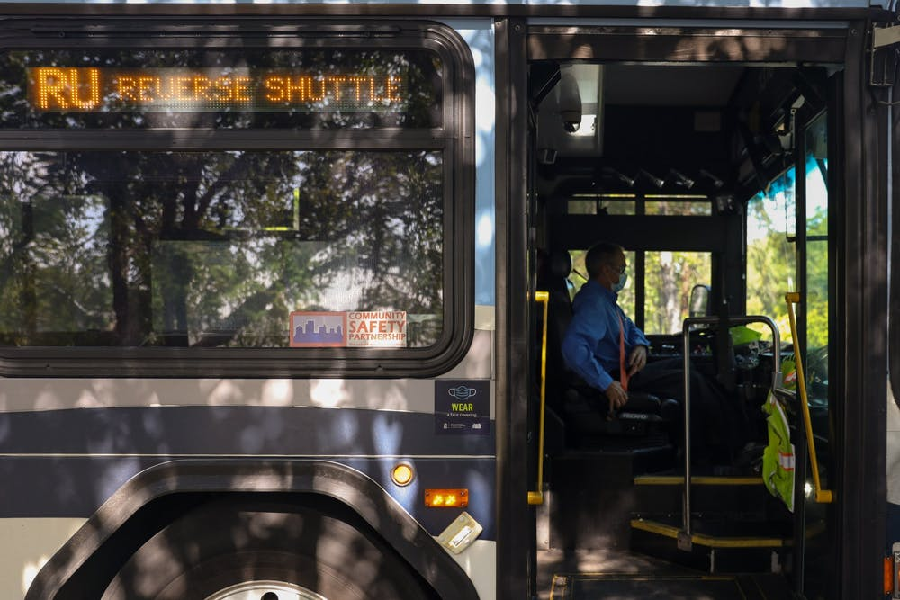 A Chapel Hill Transit bus driver buckles in their seat belt on Wednesday Sept. 15, 2021. Chapel Hill Transit is looking to install temporary changes in order to increase the reliability of the bus system in the wake of a staffing shortage.