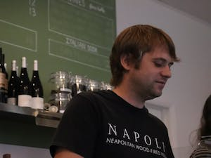 Gael Chatelain scoops gelato at his cafe, Napoli Cafe & Gelateria in Carrboro on Sunday Oct. 14, 2018. Gael and his wife own a wood-fired pizza truck and opened the new cafe on East Main Street to include coffee and gelato to customers.