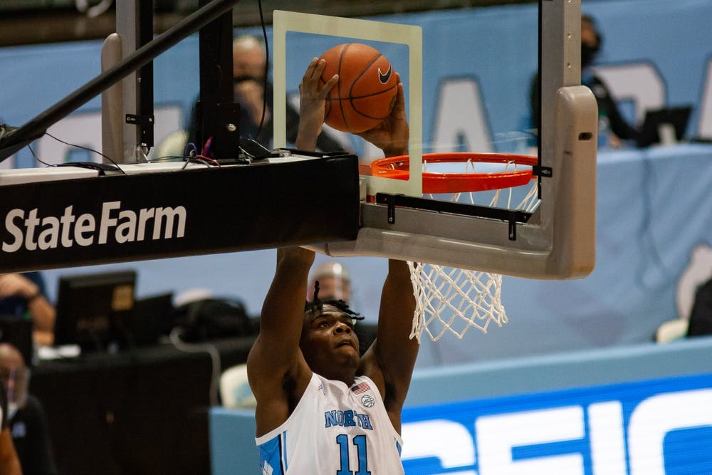 UNC first year center Day'Ron Sharpe (11) dunks the ball in the Smith Center during a game against N.C. Central on Saturday, Dec. 12, 2020. UNC beat N.C. Central 73-67.