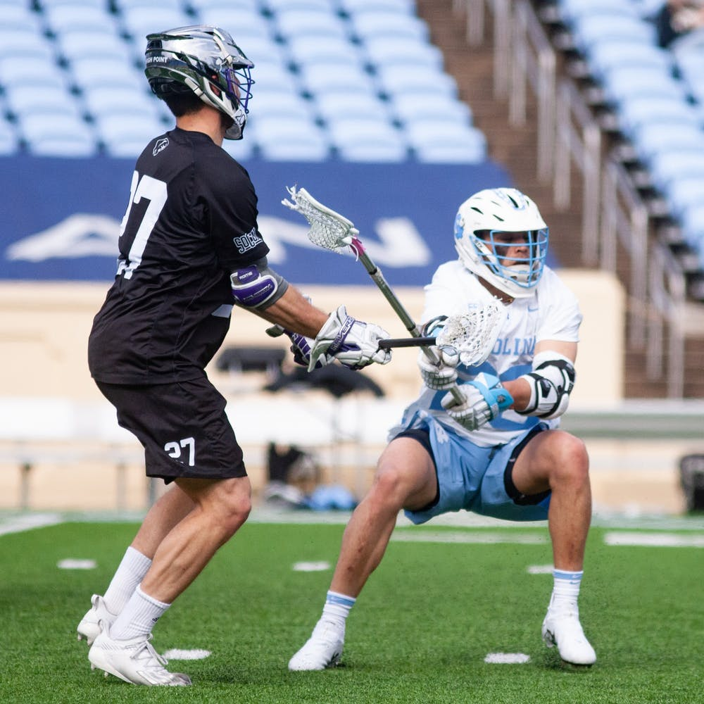 Sophomore defenseman Matt Wright (20) tries block a High Point opponent. UNC wins against High Point 27-12 at Kenan Stadium on Saturday, Feb. 27, 2021.