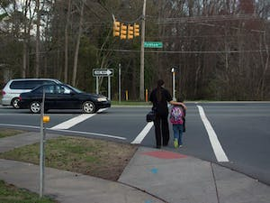 Pedestrians use the crosswalk on Fordham Boulevard. The Town Council is working on finding new locations for crosswalks.