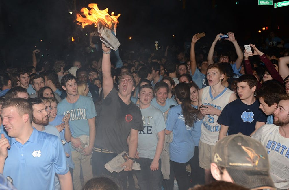"""<p><span class=""""caps"""">UNC</span> students celebrate the win after the men&#8217;s basketball team defeated Duke University on Thursday Feb. 20.</p>"""