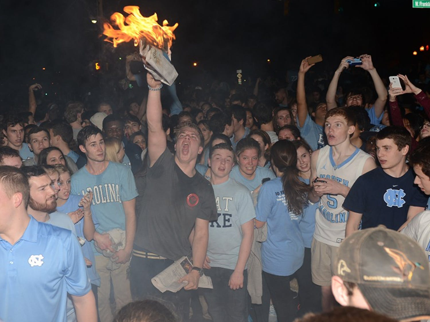 UNC students celebrate the win after the men's basketball team defeated Duke University on Thursday Feb. 20.