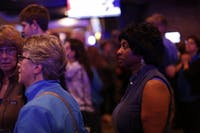 Valerie Foushee looks at voting updates during the Orange County Democratic Party's election party at Might as Well in Chapel Hill.