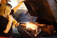 Britt Sliter of Cedar Grove and Thomas Burton of Maryland roast a pig for the annual BBQ contest.