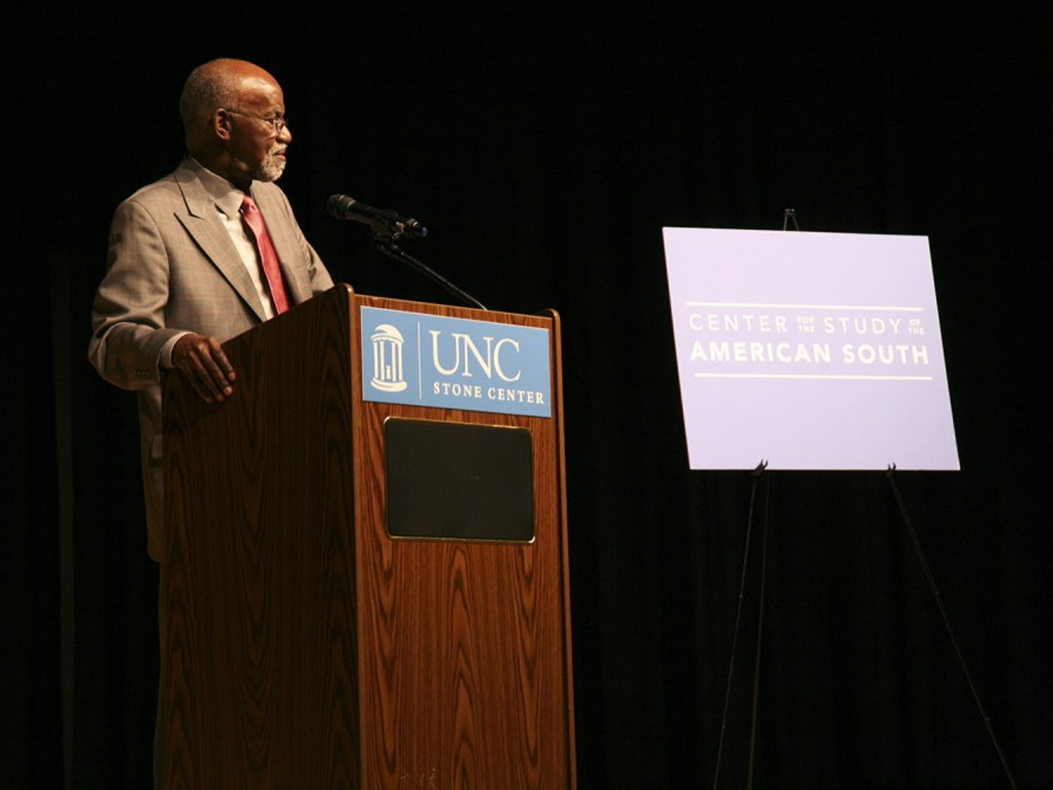 """James E. Ferguson II speaks to students, professors, and Carolina Alumni in the Stone Center theater on Tuesday night. Ferguson focuses his lecture on the Voting Rights Act and its implementation over the past fifty years. He also discusses the topic of race in the American south and how """"everything is different, but not much has changed."""""""