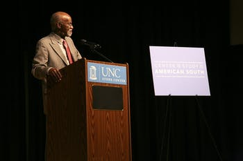 "James E. Ferguson II speaks to students, professors, and Carolina Alumni in the Stone Center theater on Tuesday night. Ferguson focuses his lecture on the Voting Rights Act and its implementation over the past fifty years. He also discusses the topic of race in the American south and how ""everything is different, but not much has changed."""