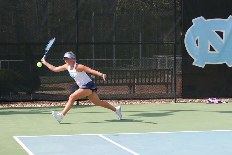 Makenna Jones returns a serve against Virginia on April 13 at the Cone-Kenfield Tennis Center.