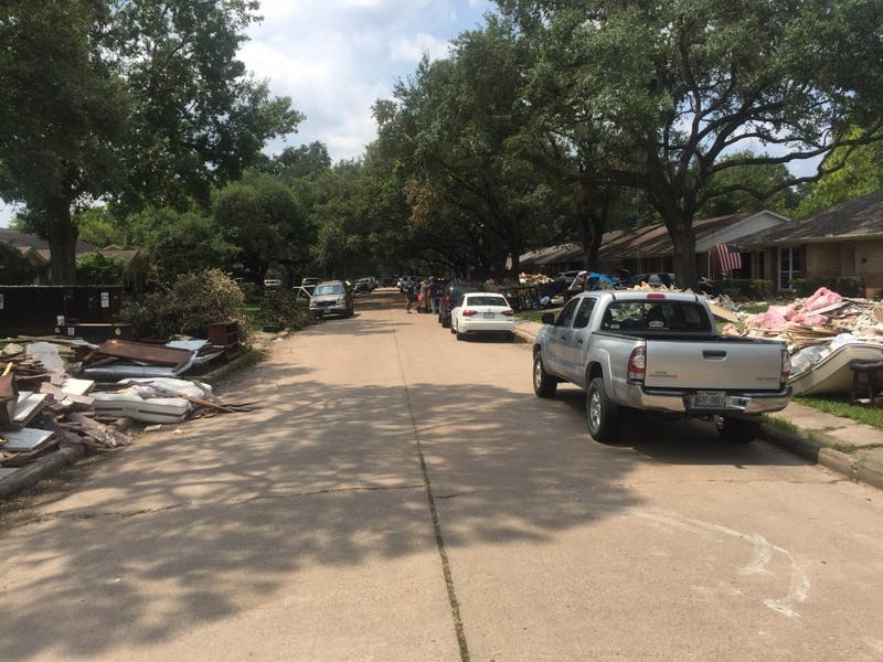 A residential street in Houston, TX during the cleanup process after Hurricane Harvey. Photo courtesy of  Valerie Mueller.