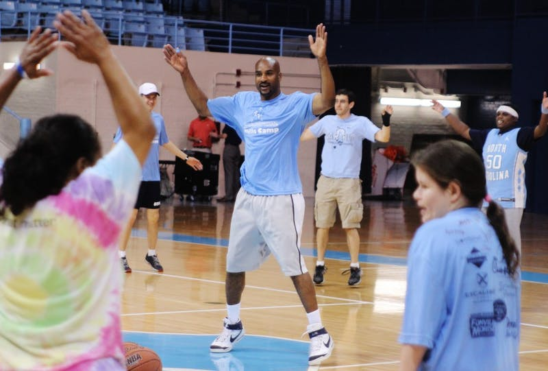 The Spectrum Skills Camp in Carmichael this morning gave special needs young adults the opportunity to play basketball together. Roger Hudson, a Tar Heel volunteer who studied Political Policy and graduated in 1996, led them in warm-up exercises.