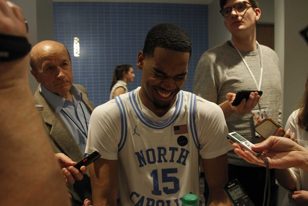 """Junior forward Garrison Brooks (15) laughs while speaking with the press after the game against N.C. State in the Smith Center on Tuesday, Feb. 25, 2020. UNC beat N.C. State 85-79. When asked how he felt, Brooks responded, """"100 (percent). I'm good. I'm good I'm good."""""""